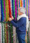 Senior Man Shopping For Tinsels — Стоковое фото