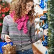 Beautiful Woman Selecting Christmas Ornaments — Stok fotoğraf