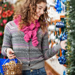 Beautiful Woman Selecting Christmas Ornaments — Photo