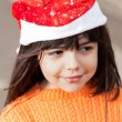 Girl In Santa Hat Looking Away — Stock Photo