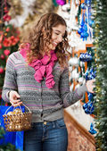 Beautiful Woman Selecting Christmas Ornaments — Stock Photo