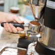 Stock Photo: Barista Holding Portafilter With Ground Coffee In Cafe
