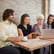 Woman With Friends Using Laptop At Cafe Table — Stock Photo