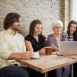 Woman With Friends Using Laptop At Cafe Table — Stock Photo #36044695