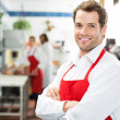 Happy Butcher Standing Arms Crossed At Store — Stock Photo