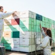 Stock Photo: Beekeepers Loading Honeycomb Crates In Truck
