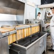 Stock Photo: Beekeeper Working On Honey Extraction Plant In Factory