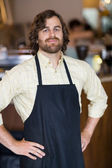 Male Owner With Hands On Hips Standing In Cafeteria — Stock Photo