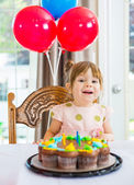 Girl Sitting In Front Of Cake At Home — Stock Photo
