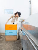 Beekeeper With Stacked Honeycomb Crates In Factory — Stock Photo