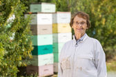 Confident Female Beekeeper At Apiary — Stock Photo