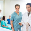 Doctor and Nurse Examin CTG report — Stock Photo
