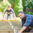 Carpenter Holding Drill At Building Site — Stock Photo #36071969