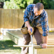 Worker Sawing Wood At Construction Site — Stock Photo #36072071