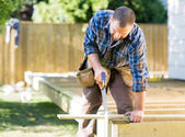 Worker Sawing Wood At Construction Site — Stock Photo