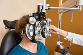Woman Undergoing Eye Examination With Phoropter — Stock Photo