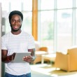 Student With Digital Tablet Standing In Library — Stock Photo #36130823