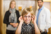 Boy Trying Glasses With Optometrist And Mother At Store — Stock Photo