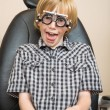 Boy With Trial Frame Making Funny Face At Optician — Stock Photo