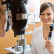 Stock Photo: Optometrist Examining Senior Woman's Eyes