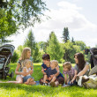 Mothers And Children Enjoying Picnic In Park — Stock Photo