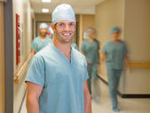 Happy Doctor With Team At Hospital Corridor — Stock Photo