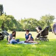 Stock Photo: Mothers With Children Enjoying Picnic
