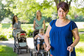 Mother With Baby Stroller At Park — Stock Photo