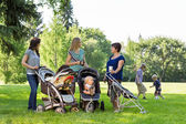 Happy Mothers With Baby Strollers — Stock Photo