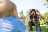 Mother Photographing Son Through Camera — Stock Photo
