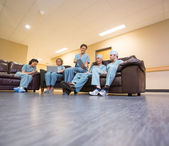 Medical Team Using Technologies In Hospital's Waiting Room — Stock Photo