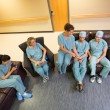 Medical Team Using Technologies In Hospital's Waiting Room — Stock Photo #36316669