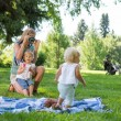 Mother Photographing Daughter In Park — ストック写真