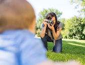 Woman Photographing Baby Son — Stock Photo