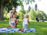 Mother Photographing Daughter In Park — Stock Photo