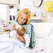 Mother Feeding Milk To Baby Girl In Hospital Bed — Stock Photo #36555131
