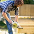 Carpenter Using Circular Saw — Stock Photo