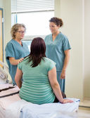 Nurses And Pregnant Woman Communicating In Hospital — Stock Photo