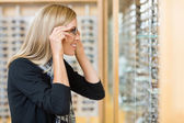 Woman Trying On Eyeglasses In Store — Stock Photo