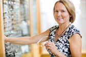 Woman Buying Glasses In Store — Stock Photo