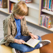Boy Reading Book In School Library — Stock Photo
