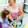 Teacher With Schoolgirl Reading Book — Stock Photo