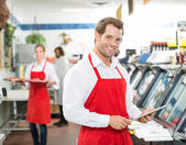 Portrait Of Happy Butcher Holding Digital Tablet At Store — Stock Photo