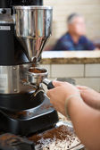 Barista Grinding Coffee — Stock Photo