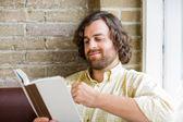 Man Reading Book In Coffeeshop — Stock Photo