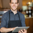 Happy Owner Holding Digital Tablet In Cafe — Stock Photo #36622195