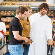 Salesman Assisting Couple In Buying Meat — Stock Photo