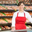 Beautiful Saleswoman Standing At Counter In Butcher's Shop — Stock Photo #36623061