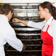 Workers Drying Meat In Oven At Butcher's Shop — Stock Photo