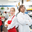 Portrait Of Confident Butchers With Arms Crossed — Stock Photo #36623711